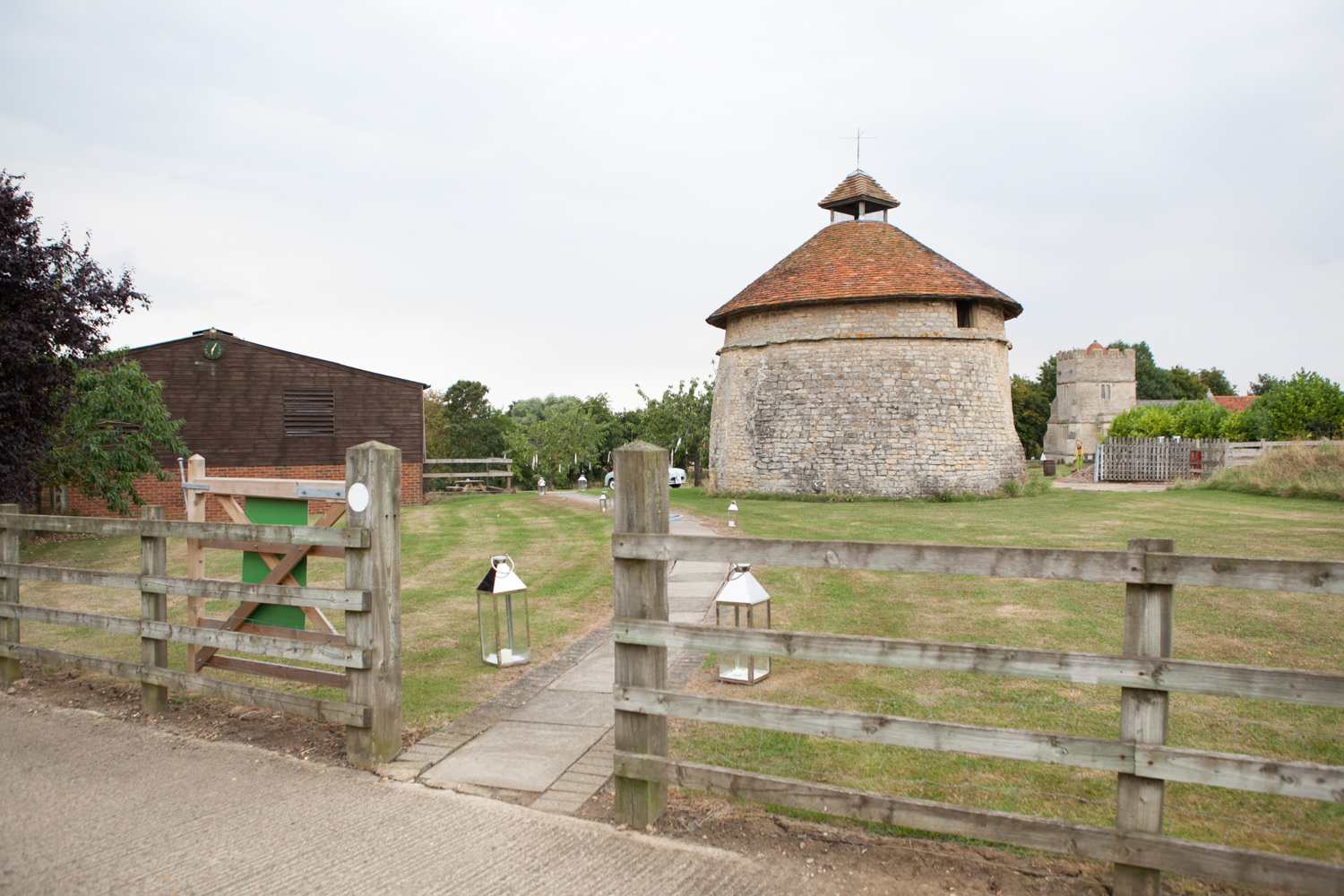 Colourful Barn Wedding Photography at Furtho Manor Farm. This is the 14th century dovecote on site.