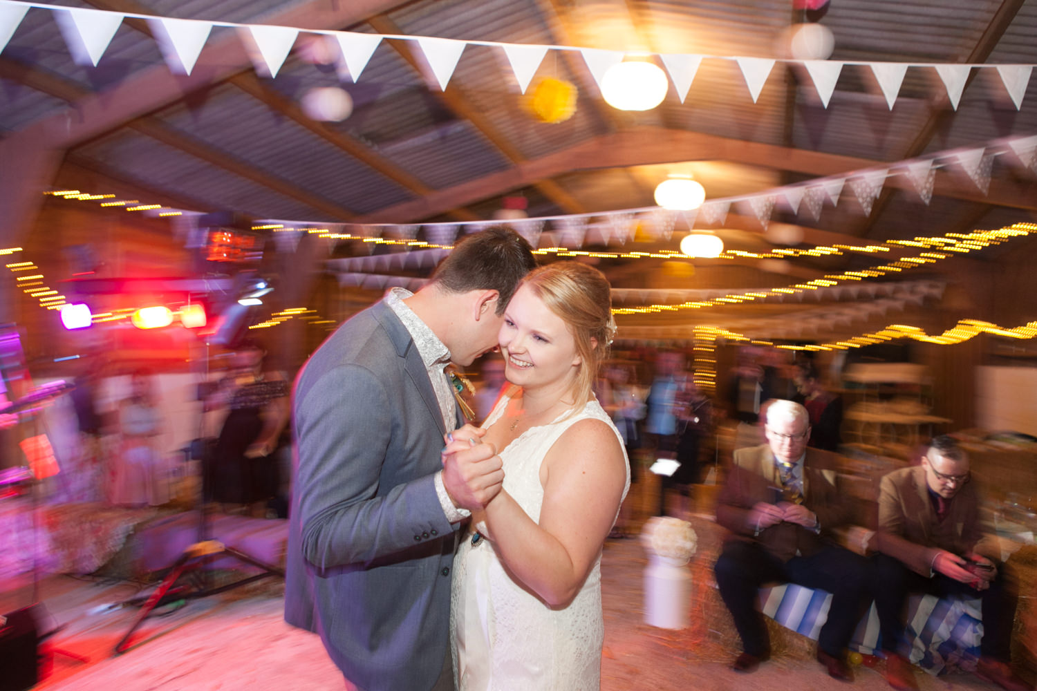 Gina & Simon's first dance at Furtho Manor Farm. Colourful Barn Wedding Photography at Furtho Manor Farm in Milton Keynes