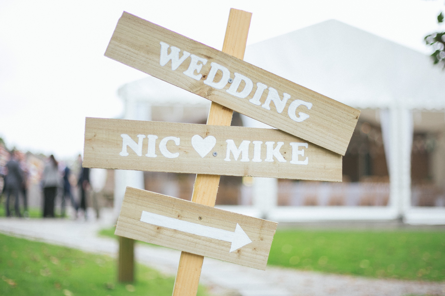 Nicola & Mike's beautiful outdoor wedding at The Green in Cornwall. The couple were lucky with the late summer sun so they made the most of the gorgeous outdoor space. Guests enjoyed champagne and games on the lawn whilst we explored woodlands and fields for some lovely couple photos. The decor was really gorgeous with an early autumn apple cider & farm theme - love the wellies and little scarecrow!! Nicola loves sunflowers so they were featured in her bouquet, on the tables. and wedding cake.