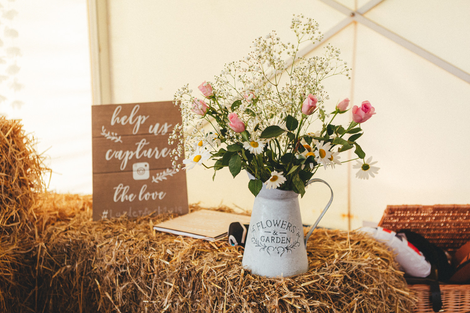 Marquee interior, set for dining. Wedding breakfast. Cornish Tipi Wedding Photographer. Wedding Photography at Cornish Tipi Weddings on the coast of North Cornwall. Cornish Tipi Wedding is set in a wooded valley, surrounded by ancient woodlands