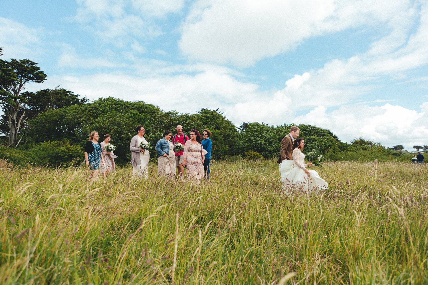 Bride on her way to the church. Bride walking. Pathway. Archway. Cornish Tipi Wedding Photographer. Wedding Photography at Cornish Tipi Weddings on the coast of North Cornwall. Cornish Tipi Wedding is set in a wooded valley, surrounded by ancient woodlands