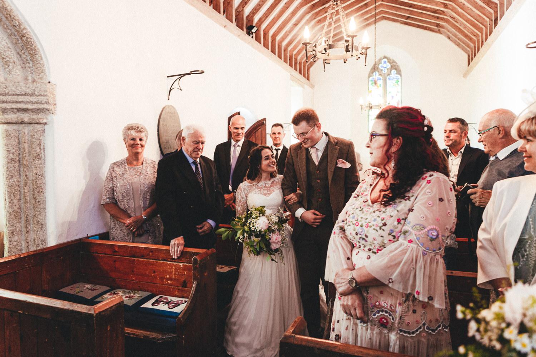 St Enodoc Church wedding photography, bride walking down the aisle