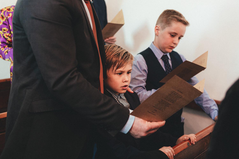 Singing hymns, St Enodoc Church wedding photography