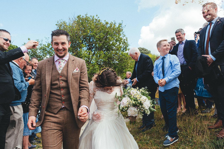 confetti line, confetti. Confetti outside St Enodoc Church. Cornwall wedding