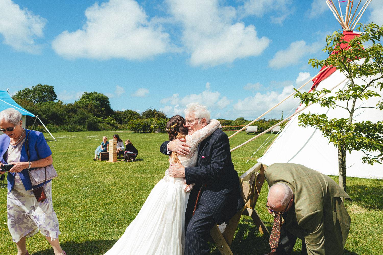 Cornish Tipi Wedding Photographer, Cornish Tipi Weddings, Wedding at Cornish Tipis, Tipi reception, Tipi wedding, bride & guests, summer wedding, outdoor wedding, June wedding