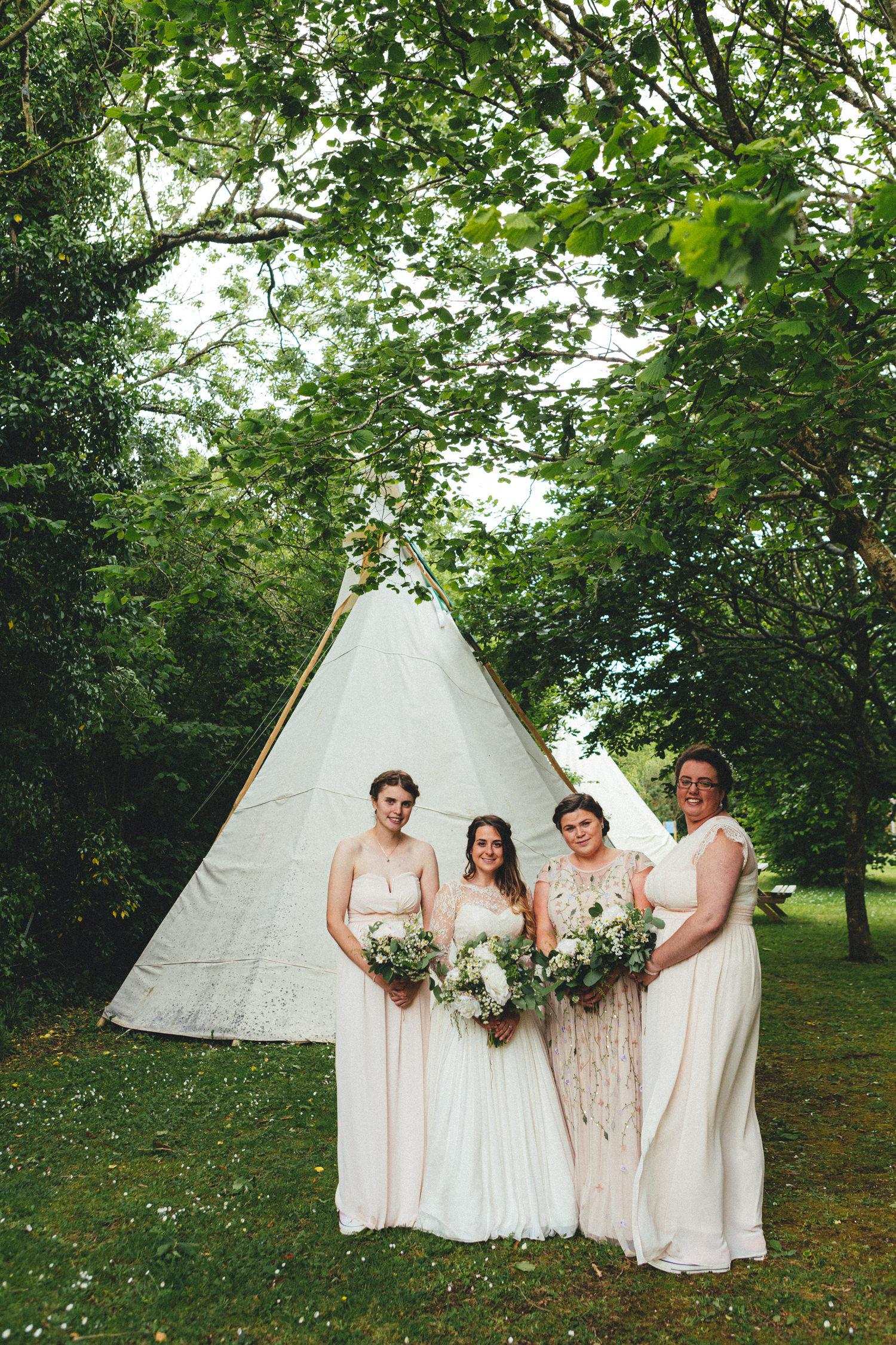 bridemaids next to tipi, tipi wedding, cornish tipi wedding photographer