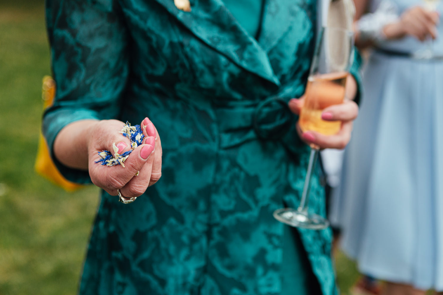 confetti, confetti in hand, champagne, garden wedding, sharpham wedding