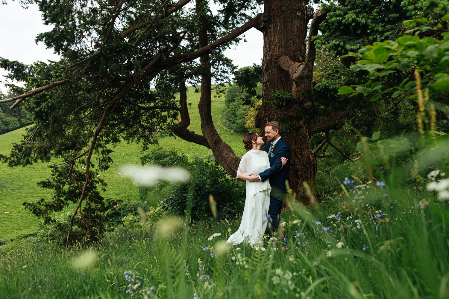 couple portrait, newlyweds, oak tree, sharpham gardens, sharpham gardens wedding photography, garden wedding, bride and groom, flowers, spring wedding, sharpham, devon wedding, outdoors