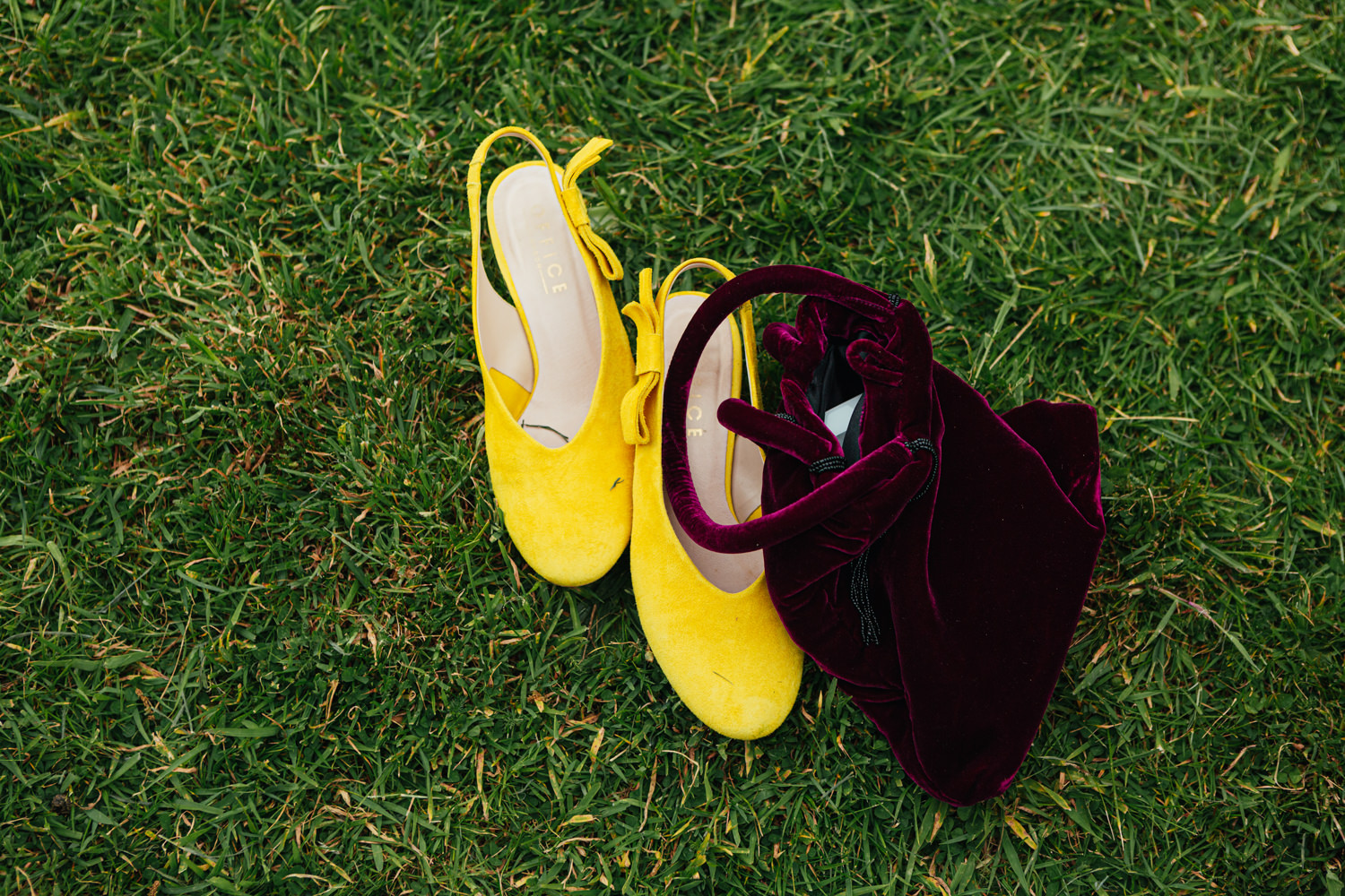 colourful bag and shoes on green grass
