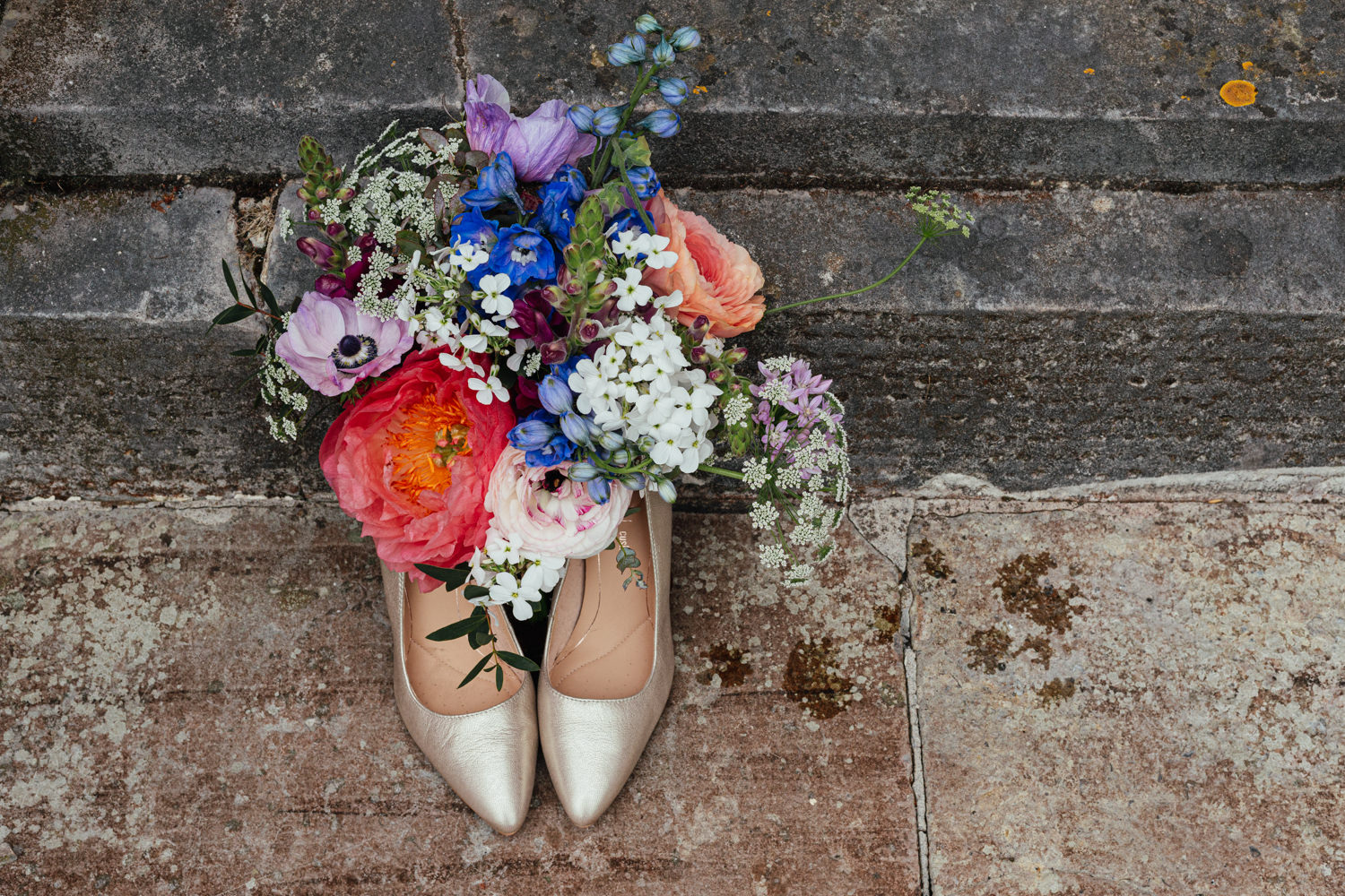 wedding detail, close-up, wedding shoes, wedding bouquet, colourful bouquet, rustic, wedding shoes and flowers, shabby chic, stonework, wedding at sharpham, sharpham house, sharpham gardens, wedding photography, devon wedding, wedding in devon, wedding at sharpham house