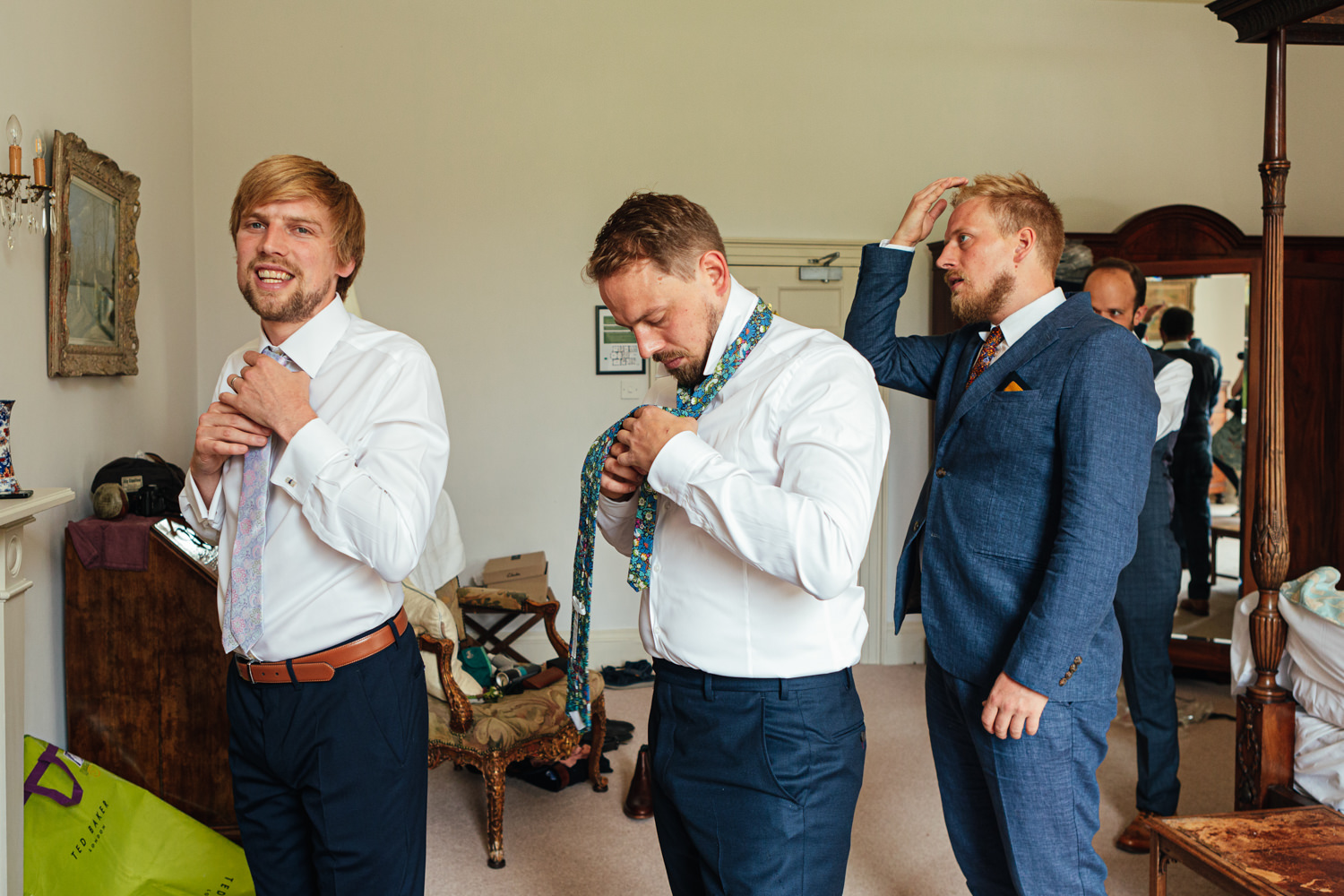 men getting dressed for a wedding at sharpham house, groom getting ready, sharpham house wedding