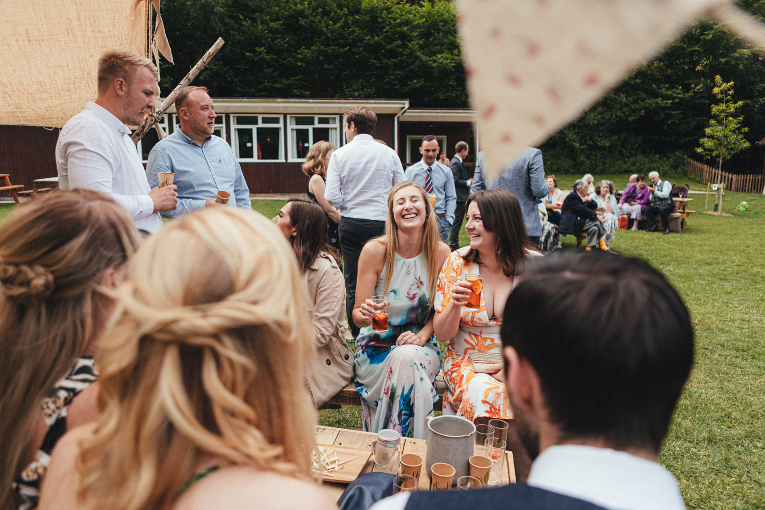 wedding guests at great wood camp, woodland wedding