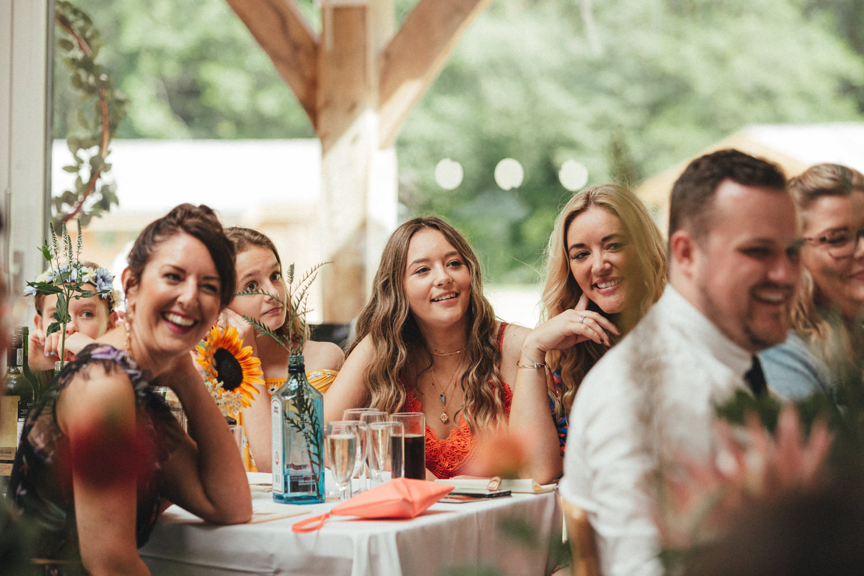 wedding guests at great wood camp, woodland wedding