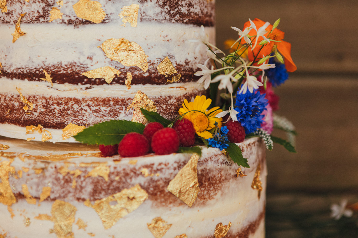 colourful wedding cake, boho wedding, boho bride, hippy wedding, farm wedding, flowers on cake, bright colours, Holsome Park Wedding Photography, totnes wedding, farm wedding, festival wedding