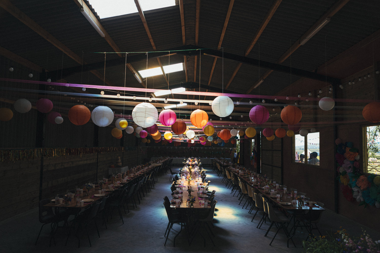 colourful wedding decor, wedding breakfast, barn, wedding barn, boho wedding, boho bride, hippy wedding, bright colours, Holsome Park Wedding Photography, totnes wedding, farm wedding, festival wedding