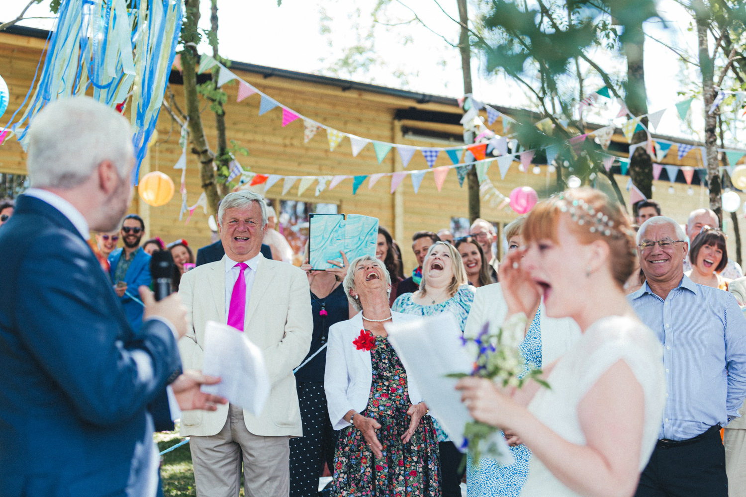 guests laughing, colourful wedding, festival wedding, Holsome Park Wedding Photography
