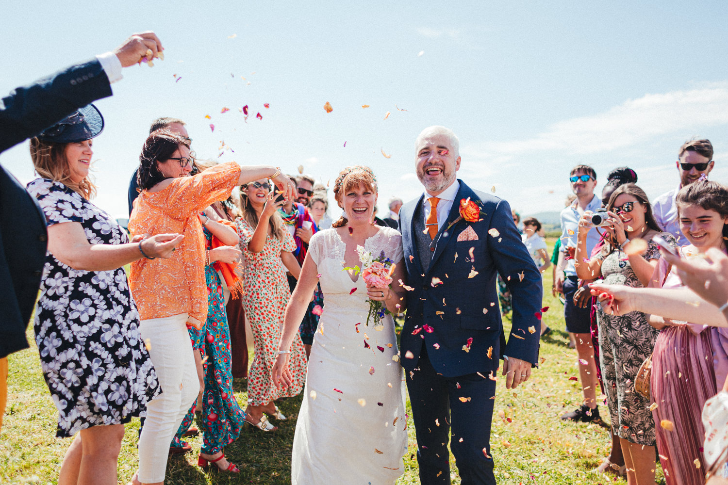 confetti, confetti line, bride & groom, festival style wedding, colourful wedding, festival wedding, Holsome Park Wedding Photography