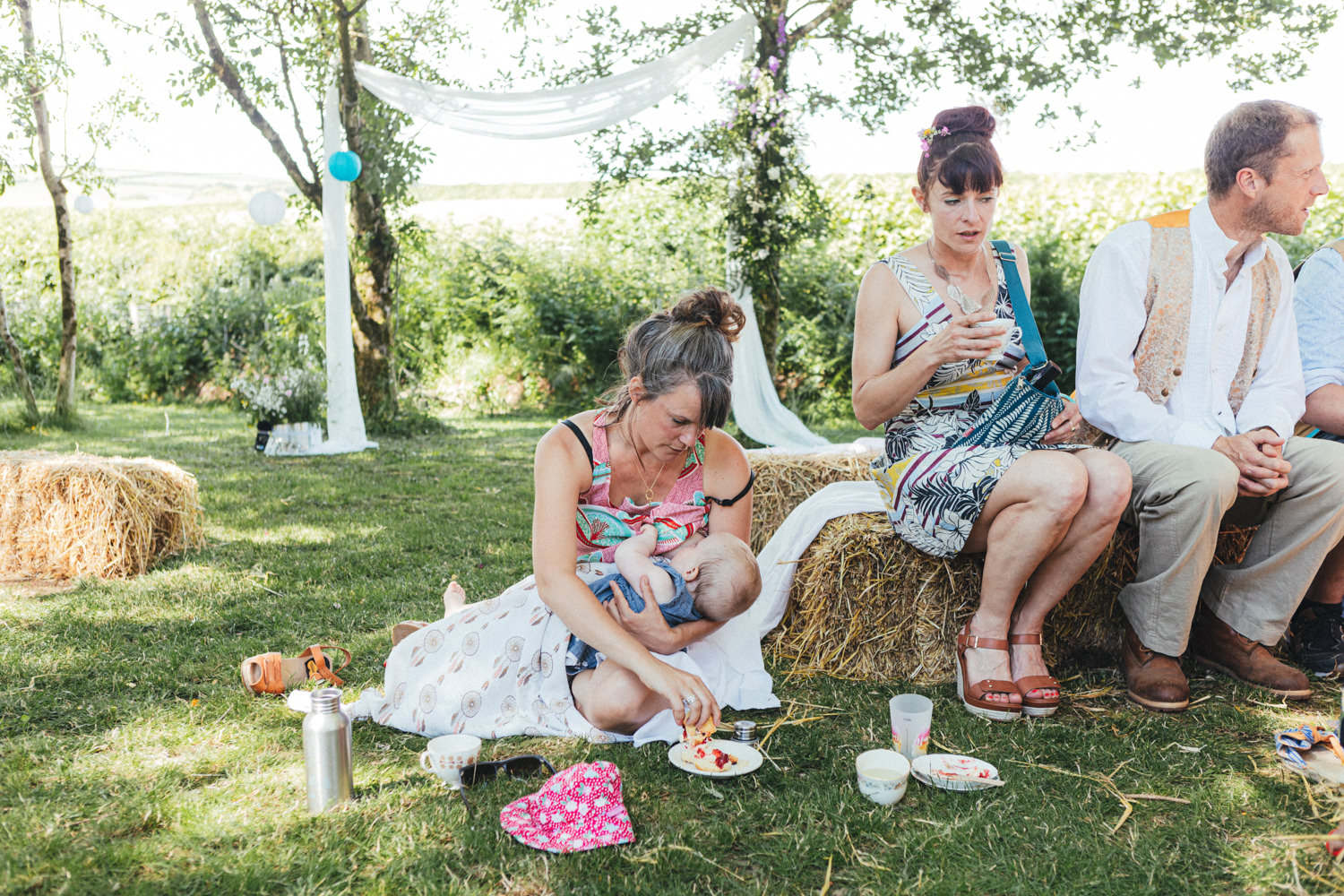 breastfeeding wedding guest, breastfeeding mum, Holsome Park Wedding Photography, festival wedding, wedding guests, outdoor wedding, summer wedding
