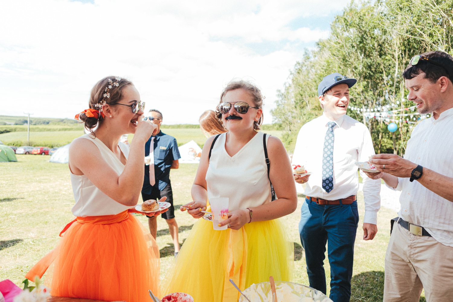 bridesmaids with fake moustache, Holsome Park Wedding Photography, festival wedding, wedding guests, outdoor wedding, summer wedding