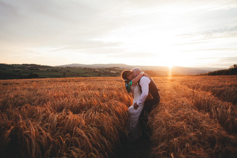 bride and groom, portraits, sequinned coats, alternative wedding, devon wedding, glitter, barley, barley field, totnes wedding, devon wedding photographer, summer, harvest, Holsome Park Wedding Photography