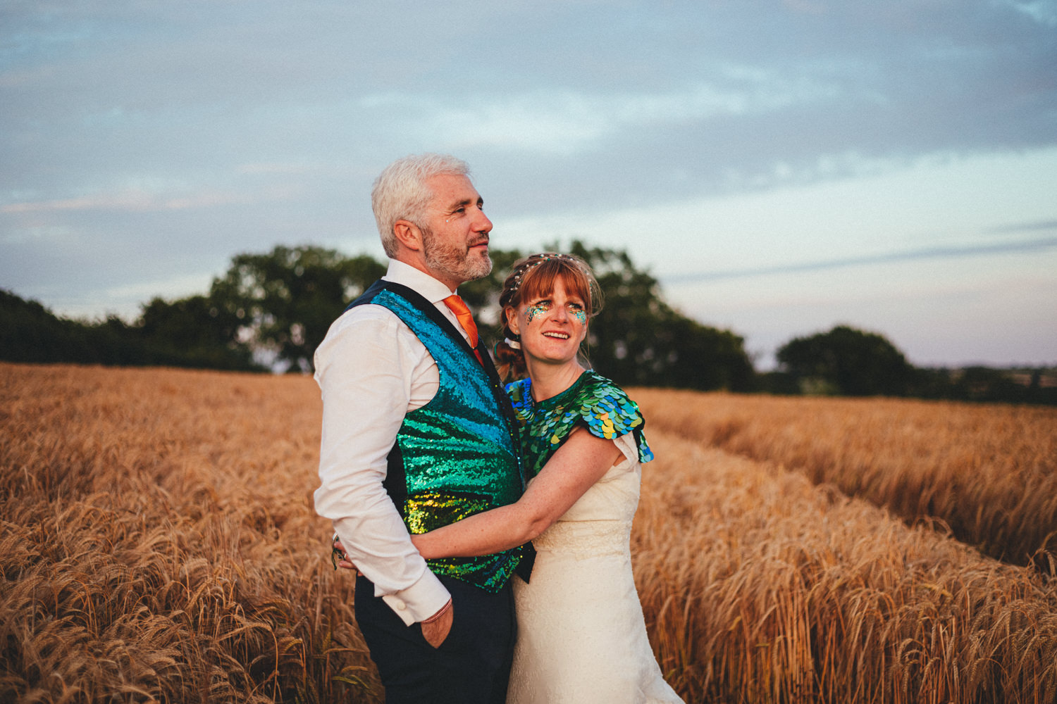 bride and groom, portraits, sequinned coats, alternative wedding, devon wedding, glitter, barley, barley field, totnes wedding, devon wedding photographer, summer, harvest, Holsome Park Wedding Photography