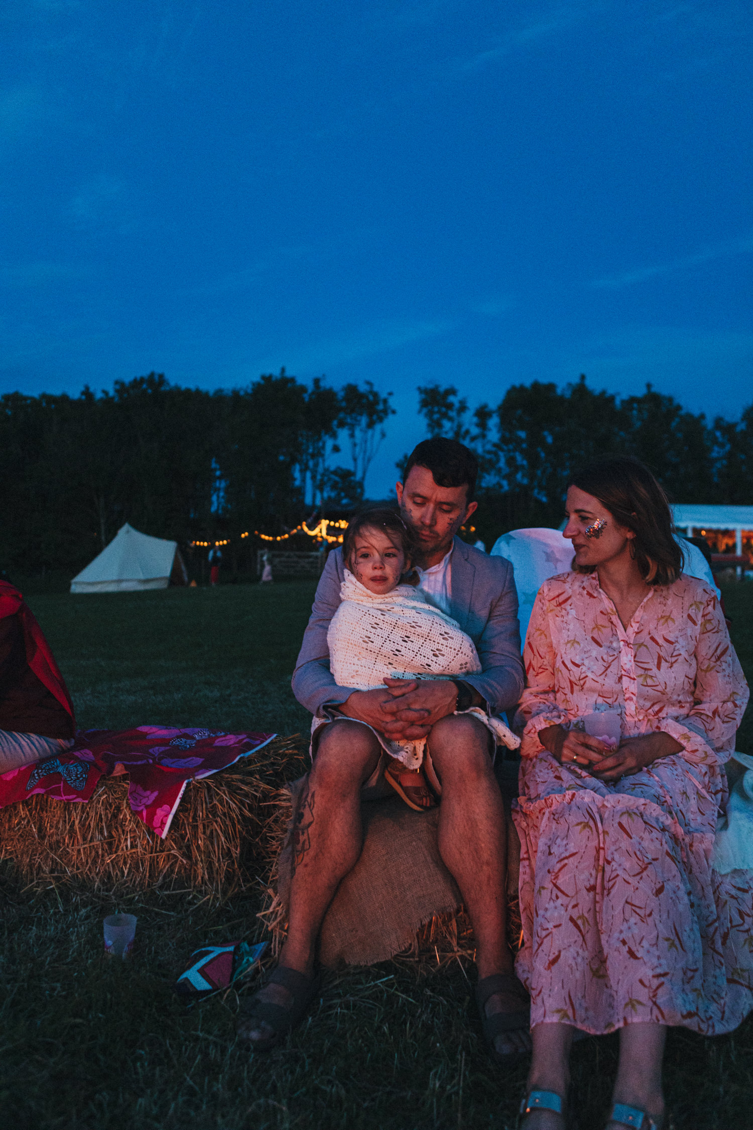 guests by the fire, little girl, family, blue hour, twilight, straw bales, moonlight, Holsome Park Wedding Photography