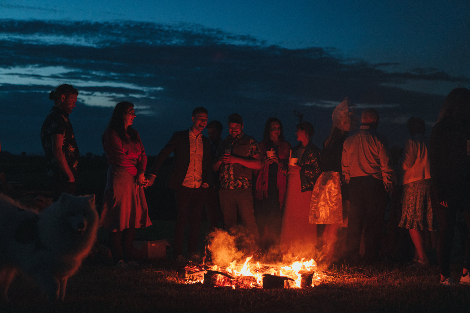 guests by the fire, fireside chats, Holsome Park Wedding Photography
