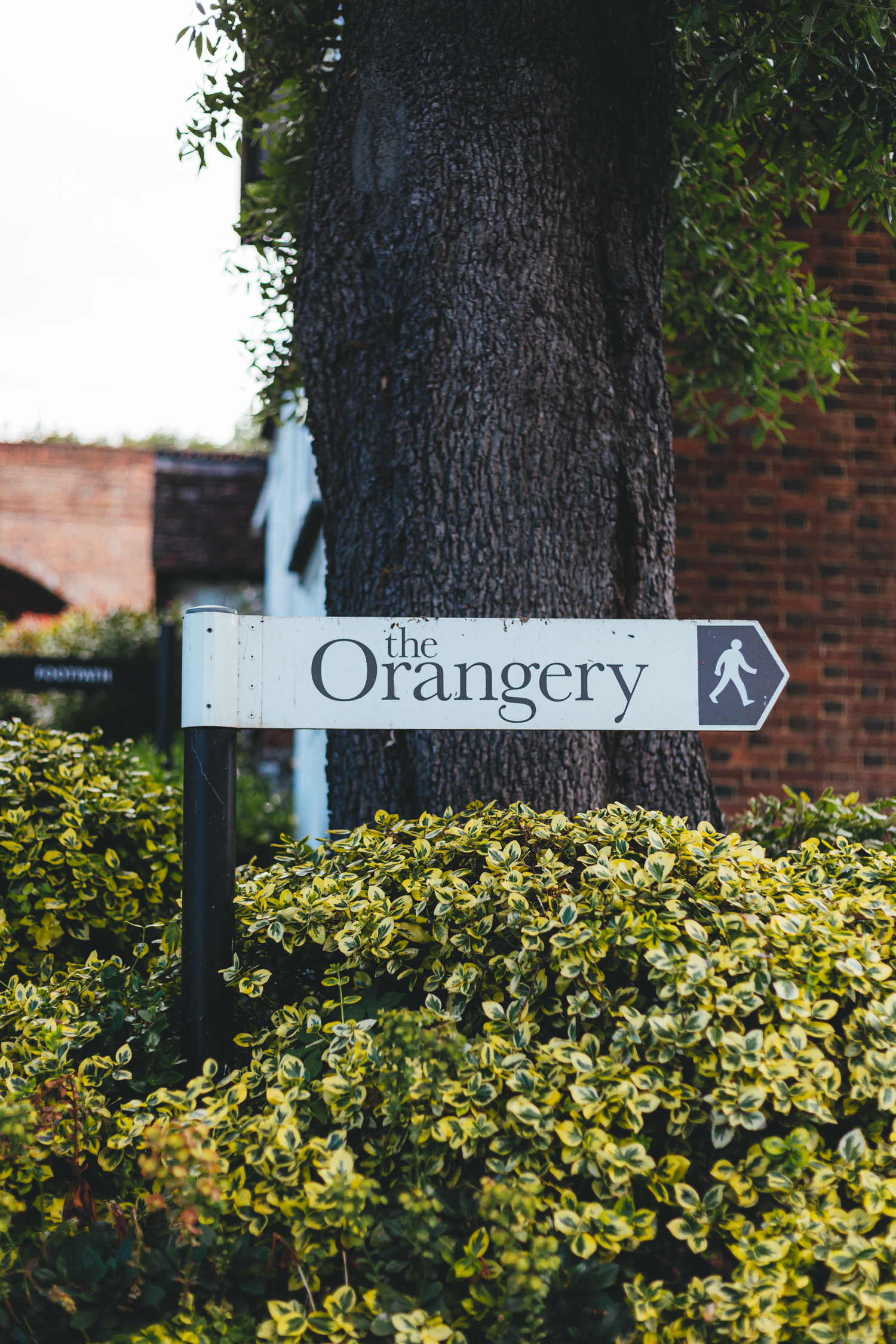 Quirky Woodland Wedding Photography, the orangery maidstone, sign, wedding venue