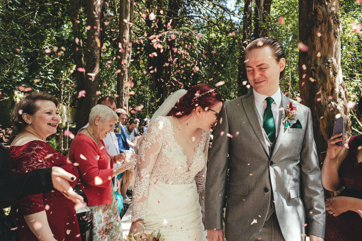 confetti, bride & groom, woodland walkway, woodland wedding, alternative wedding, Quirky Woodland Wedding Photography